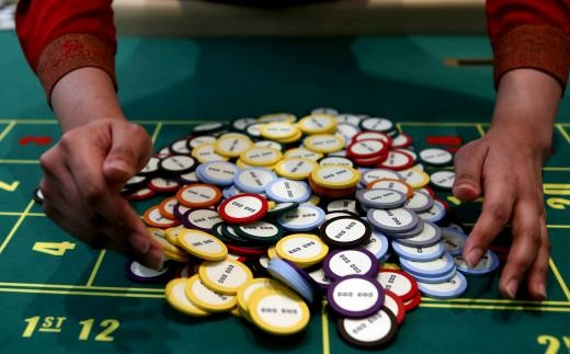 A casino dealer collects chips at a roulette table in Pasay city, Metro Manila